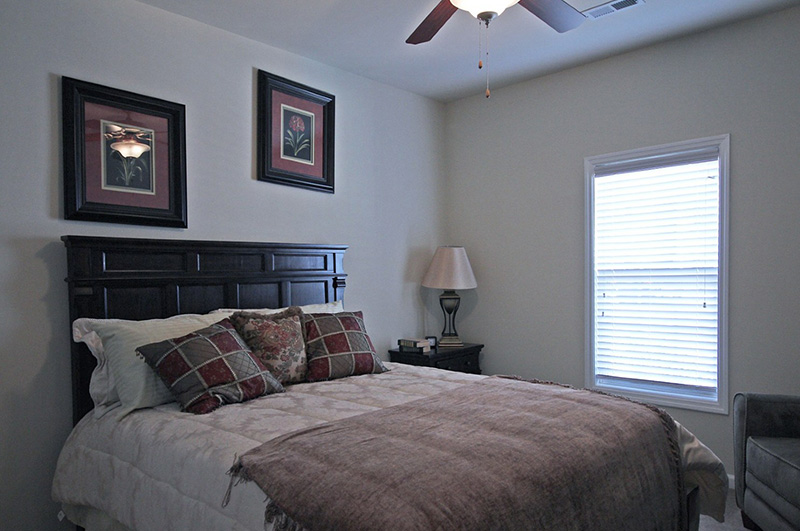 Bedroom with Large Window and Ceiling Fan